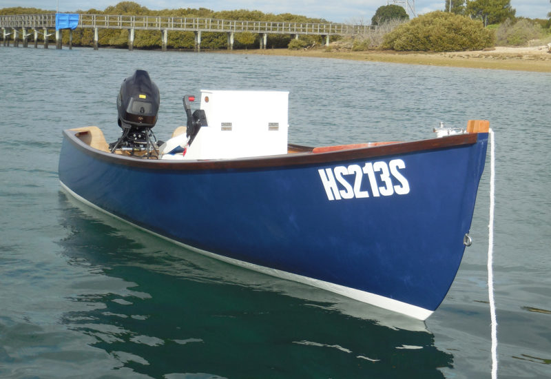 """Tom Hill writes about the skiff: """"Her high, full, and flared bow makes for a surprisingly dry rid to windward in a chop. Running downwind, her gentle stem curve, moderate deadrise, and round bilges make her forgiving and steady."""""""
