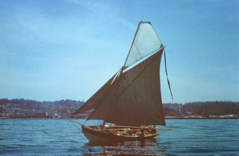 I have a few photos of Marblehead dory skiff with a topsail and outer jib added, but no record of the fifth sail, a flying jib.