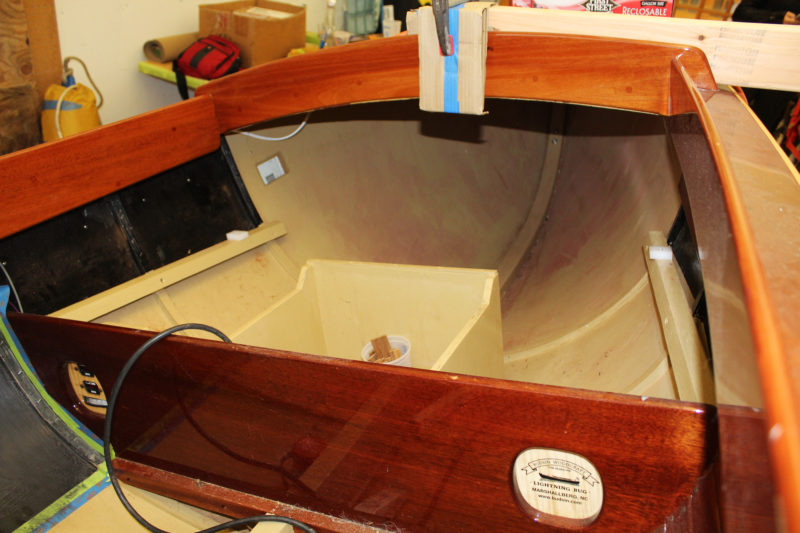 Removing the forward seat reveals the box for the main batteries and the storage area under the foredeck.