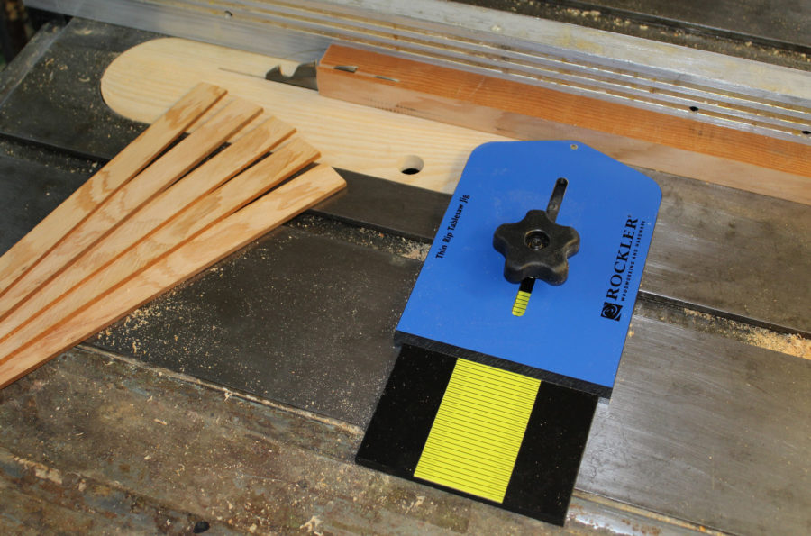 The ball-bearing equipped jig, along with a shop-made zero-clearance table-saw insert, makes ripping strips for laminations safer than sawing thin stock the on the fence side of the blade.
