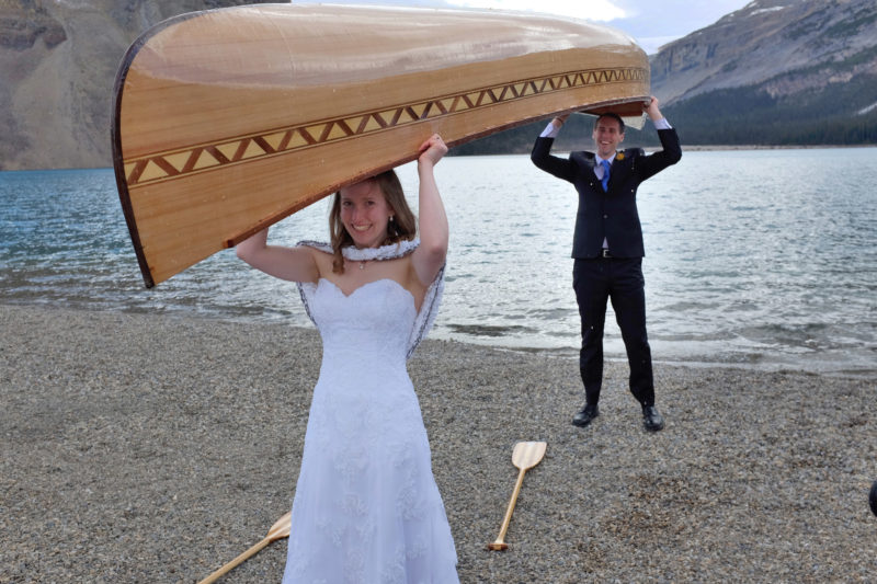 It was to to go canoeing and their wedding finery would have to do as paddling garb.