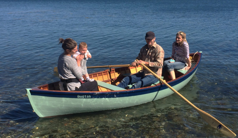 """Friends and family explore the tide line. With the centerboard up, the peapod only draws 7""""."""