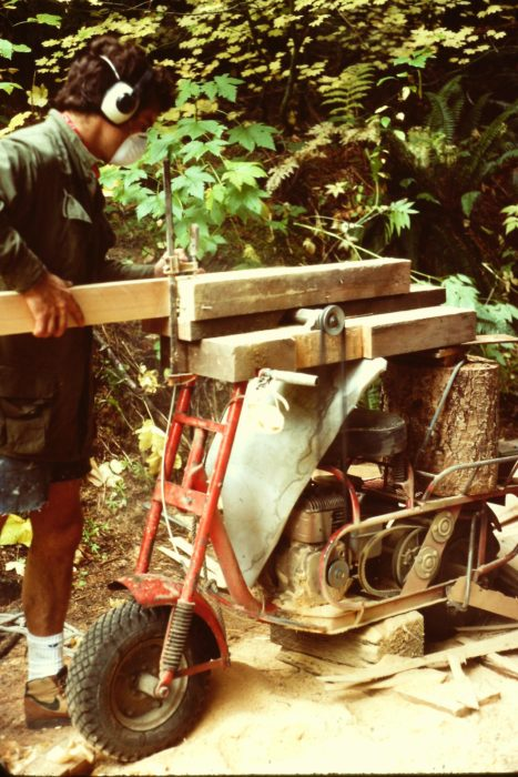 My tote-goat's motor powered the jury-rigged table-saw I used to resaw red cedar for planking. A cord wrapped around the throttle and connected to a stick with one end resting on the ground let me control the engine with my foot.