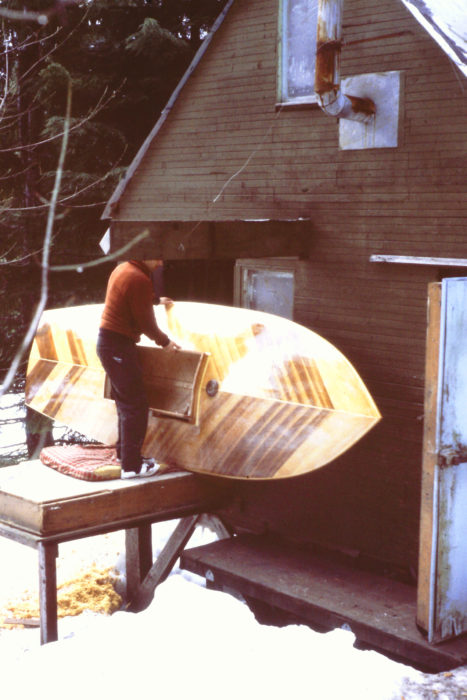 In the middle of my last winter in Monte Cristo, I moved to a cabin on Lopez Island in Washington State's San Juan Islands. When the sneakbox was ready to leave the shop, I made a sled for it out of old skis and towed it to the road behind an aging snowmobile. Halfway down the 14 miles of unplowed road, the muffler fell off. Fortunately I always wore hearing protectors with me and the jet of flame shooting across my right shin didn't set my pants on fire.