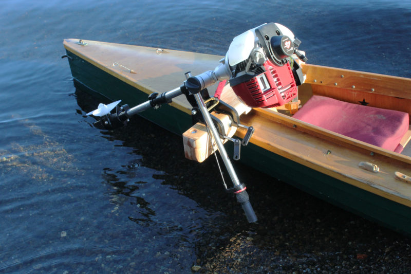 The light weight of 4-stroke Aqua Bug (shown here) and its 2-stroke cousin are both light enough to be side mounted on a canoe without overwhelming its stability.