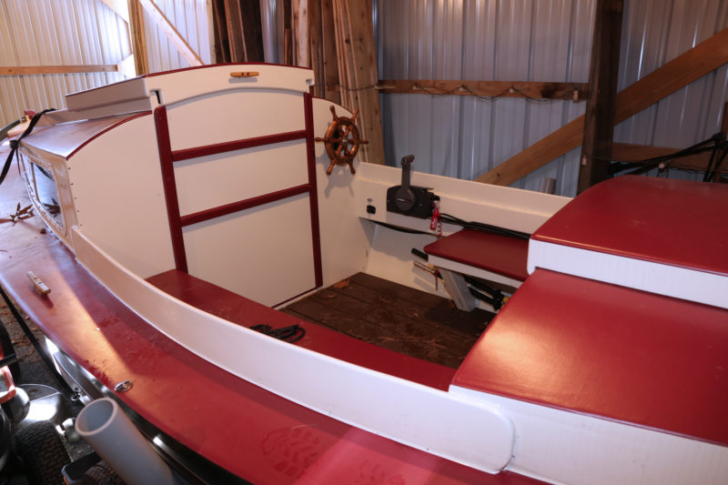 The Redwing can be built with the wheel and controls on the motor well, but Barry chose to put the helm forward to put his boat in better trim.