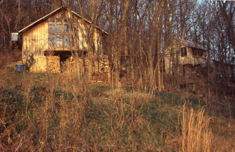 The Hubbards' home gets bathed in the evening light as the sun sets over the Ohio RIver. Harlan's studio it the the right.