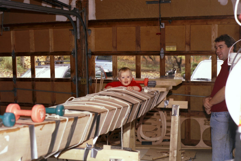 A young Thatcher gave his dad a hand during the construction of a stitch-and-glue kayak kit. The Unfried family, as all normal families do, use the garage for boats and leave the cars outside.