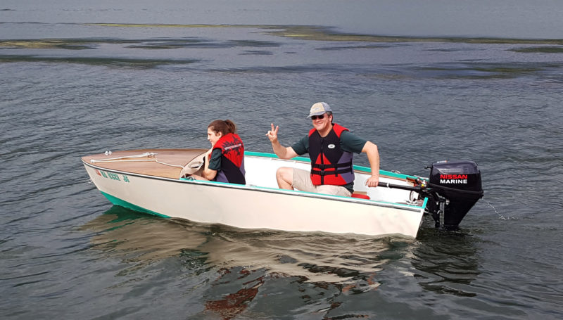 The author powers his Utility with an 8-hp four-stroke outboard. It didn't perform as well with two adults aboard as Atwood's two-stroke 8-hp did.