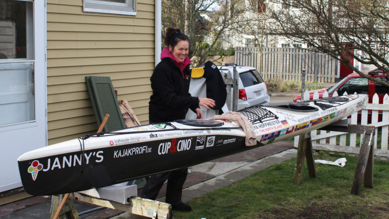 Freya's kayak was designed and built to meet her specifications. The dip in the sheer line maintains buoyancy and cargo capacity in the bow while providing clearance for her paddle stroke. Stickers lined up alongside the cockpit are flags of the 19 nations where she has paddled the entire coastline.