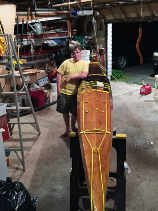"Thatcher named his kayak YELLOW SNAPPER ""because she is yellow, fast, and it reminds me of the yellow snapper fish. The fish are fast and beautiful, just like my boat. The bungees make a sharp snapping noise too."""