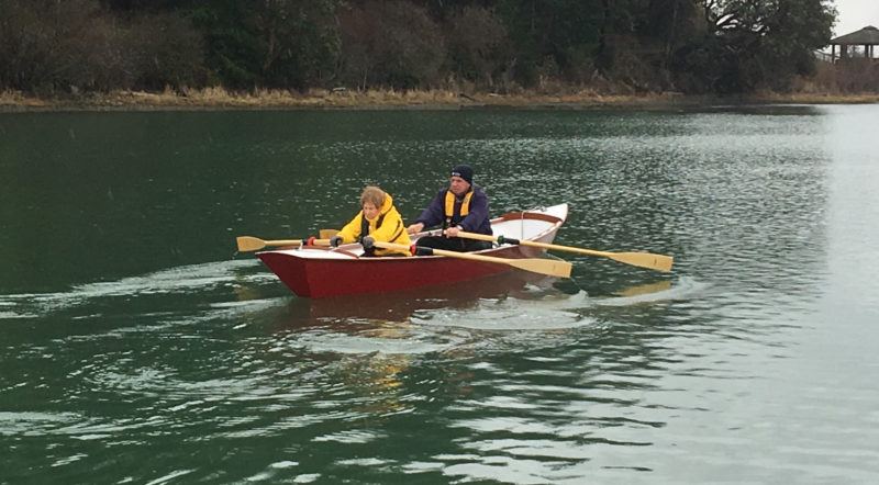 SCARLETT is a Fairhaven Flyer built for tandem rowing with fixed thwarts and gunwale-mounted oarlocks.