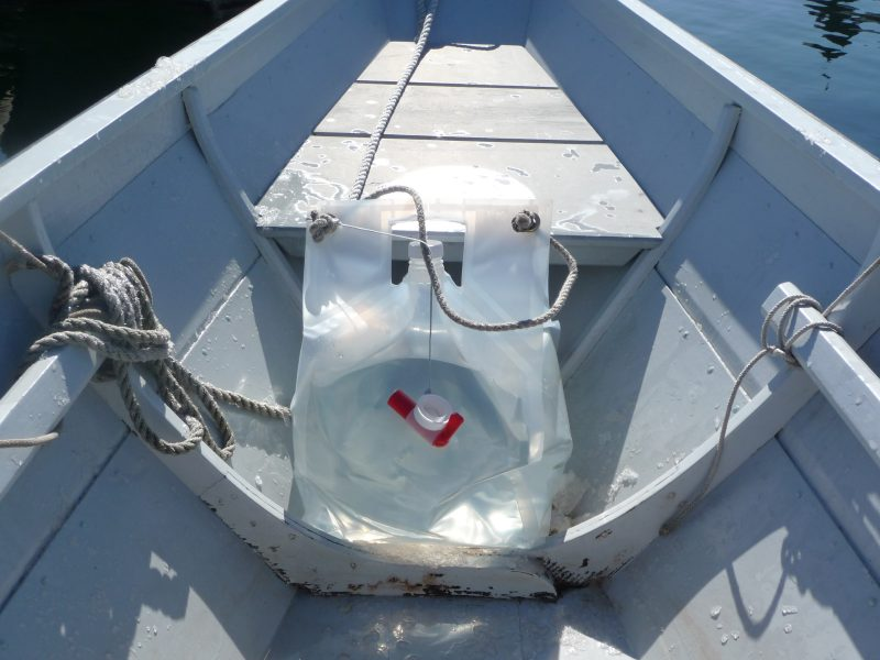Five gallons of water provide 40 lbs of ballast in the stern of the author's Swampscott dory.