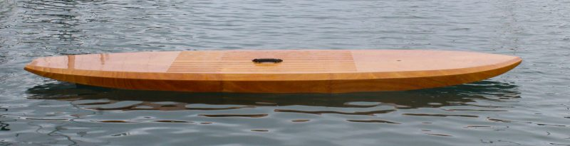 Floating without a paddler aboard, the rocker of the bottom is evident.