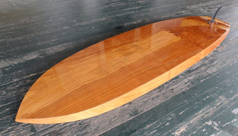 The forward and middle sections of the bottom are cut from the same piece of plywood so the grain and color runs through the forward puzzle joint.