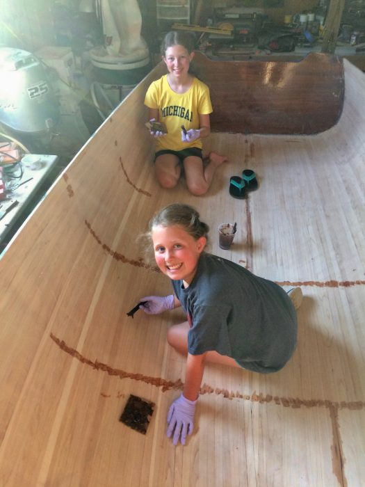 Hannah enlisted Kyla's help in filling all those screw holes on the interior. This team effort really sped up the process and working with a buddy is always more fun.