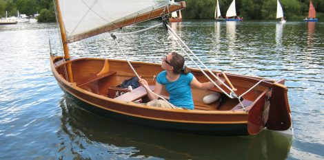 The floorboards provide comfortable, dry seating while sailing in light air.
