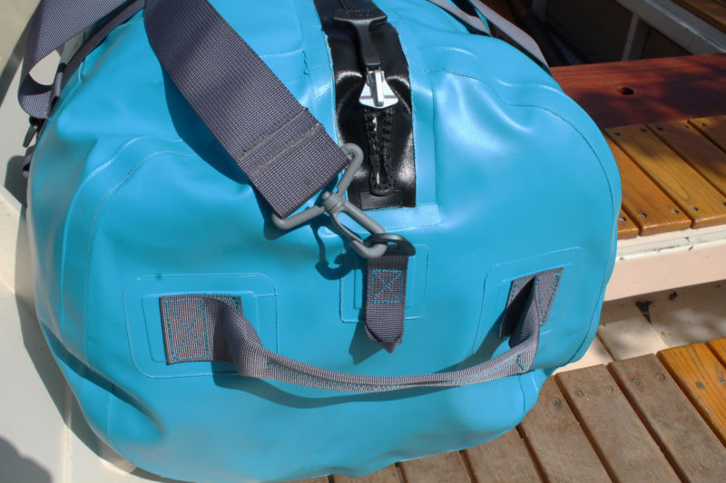 The Expedition DriDuffel has a waterproof Tizip zipper, a shoulder strap, and handles on each end.