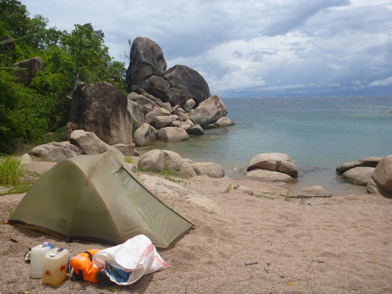 My campsites were often stunning spots. Almost every night I found myself alone on sandy beaches, between boulders and lush greenery and looking over the lake toward the Congo on the other side. Here you can also see my jug of tablet-purified water, the gas for my stove, my PFD and my drybag, which I kept inside another sack to protect it from sun and abrasion