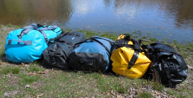 From left, the NRS 70-L Expedition DriDuffel, the Watershed 105-L Colorado, the SealLine 75-L Zip Duffle, the Ortlieb's 60-L Duffle, and the Seattle Sports 50-L Nav Duffel