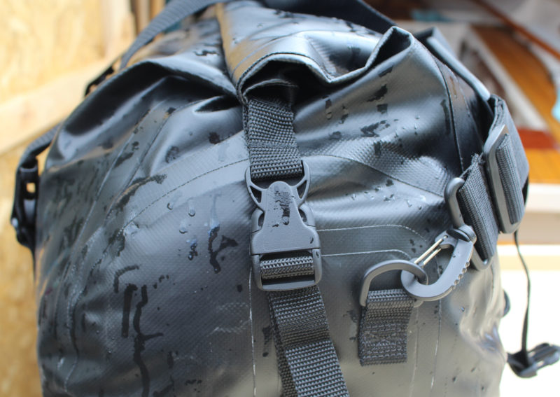 The ends of the duffel have buckles to secure the roll-down closure and D-rings for a shoulder strap.