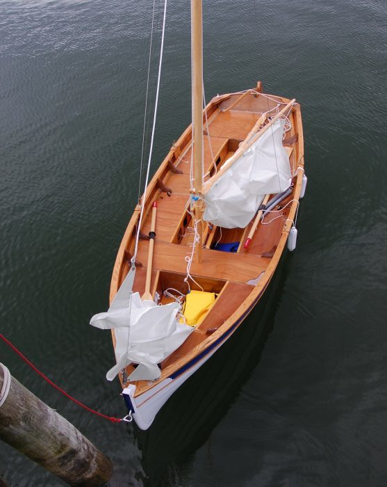 The gunter rig requires standing rigging—a forestay to a stemhead fitting and shrouds to the forward pair of oarlocks—but both the schooner and the ketch rig have freestanding masts.