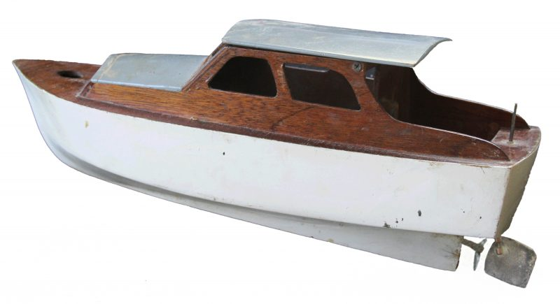 "The 15"" cabin cruiser has a motor powered by four C cells. It's over a half century old and still works."