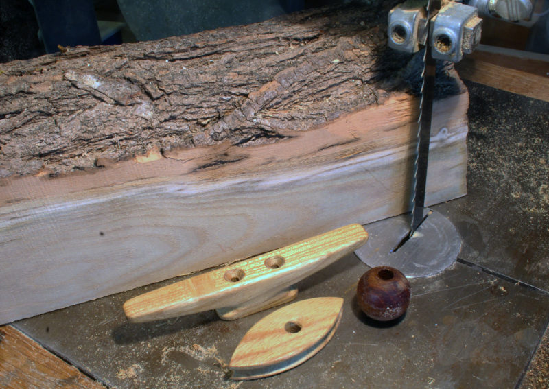 The wood I like  best for cleats, snotter thimbles, and parrel beads is locust, and I get all I need for free by the side of the road after a wind storm. Making the first cuts on the bandsaw used to be the part of the process that made me rather nervous.