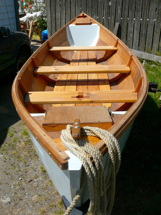 Easily removable thwarts and broad floorboards provide room enough for bedding down at anchor.