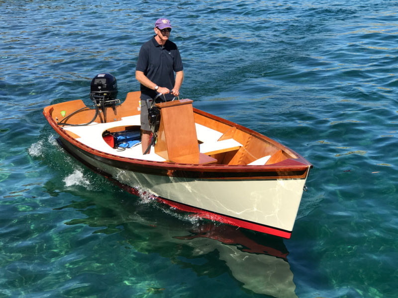 The fuel tank rides just in front of the transom. The motor is bolted on to give it a solid, permanent connection to the boat.