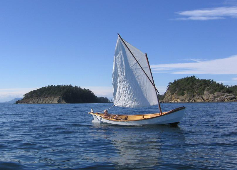 The loose-footed sprit sail makes sailing about as simple as it gets. Light summer breezes make for unhurried passages between islands.
