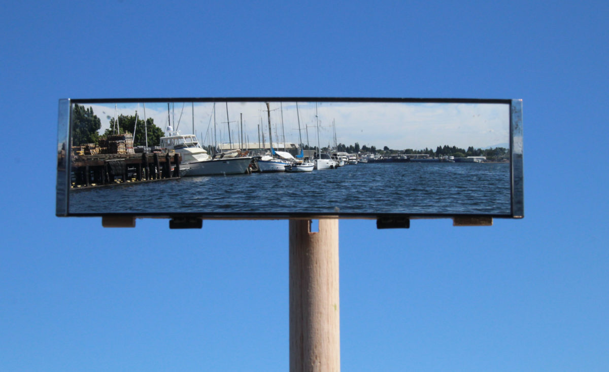 The wide-angle mirror shows what's ahead as well as enough of a view to the side to hold a course at the right distance from shore.