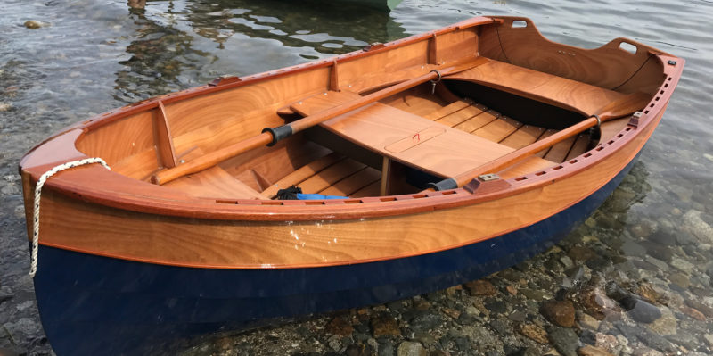 The transom and the full bow offer room to stow proper oars. Handholds in the transom ease handling the boat on a cart and launching into a chop from a beach.