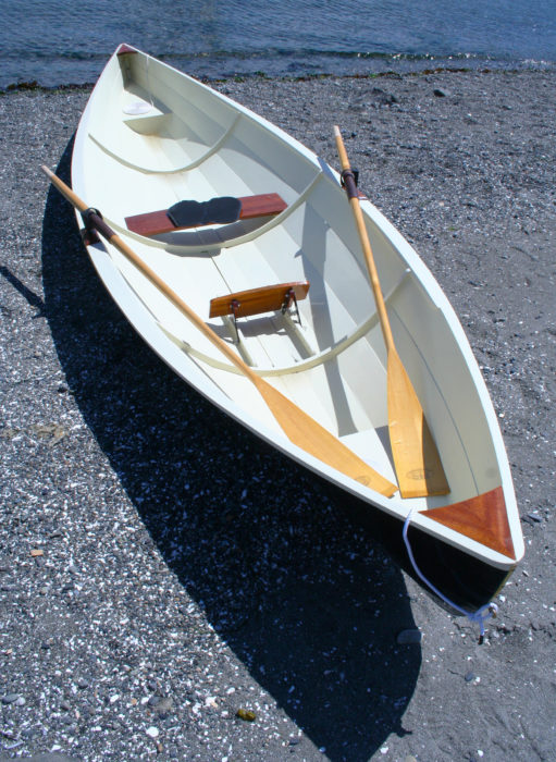 With no keel and very little deadrise to the garboards, the Raceboat won't roll on its side when resting on a beach.