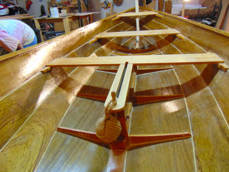 "As engineer and longtime woodworker, Scotty is, by his own admission, ""a bit ticky about correctness, so construction took awhile."" His tidy work with the epoxy fillets paid off in the bright-finished boat."
