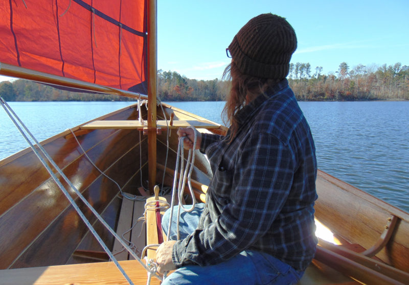 "When Scotty taught Juilio how to sail, she was quick to pick up the skills and ""the touch."" She's handling the main sheet here, but Scotty notes: ""She's the best helmswoman I've ever sailed with."""