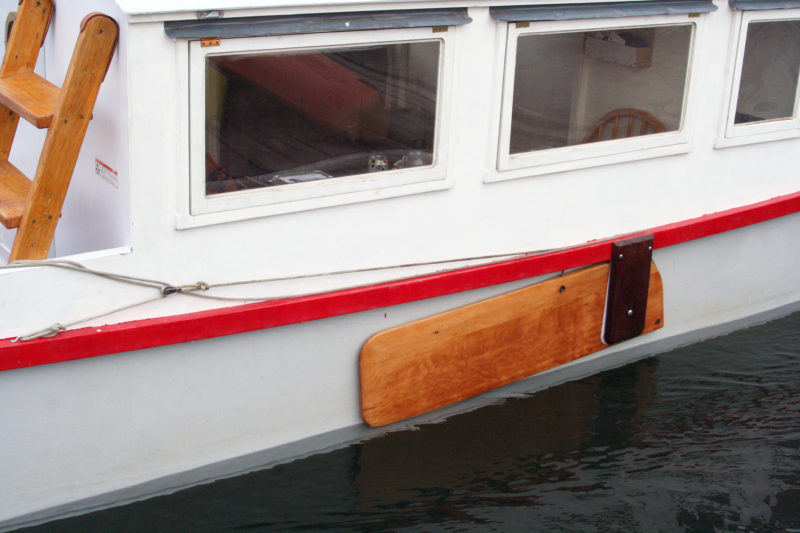 The dark ipe board on the outside of the leeboard is meant to provide a structure stronger than a pivot bolt going through the leeboard and the hull.