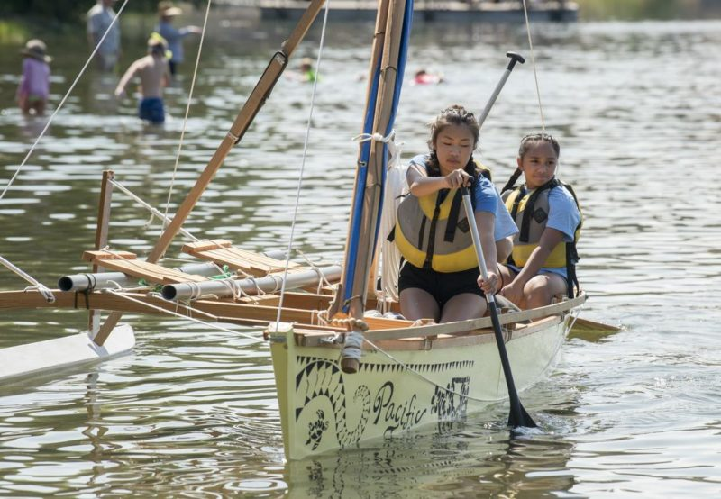 Students paddle their decorated outrigger.