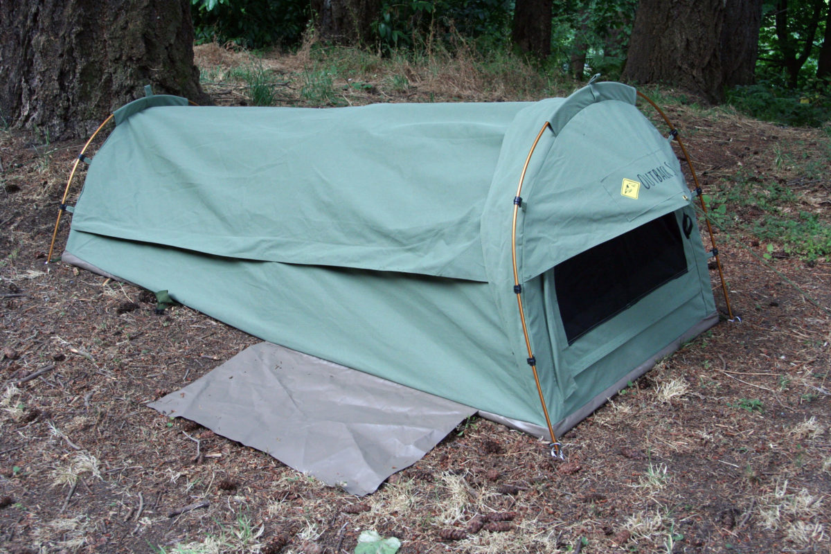 Closed up against rain or cold, the tent is cozy without feeling cramped. The attached flap of PVC vinyl provide a place to take off shoes before entering to keep dirt out of the tent.