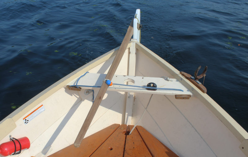 The bungee doesn't need to be removed to use the tiller. Just push it or pull it and it will hold the new rudder angle.