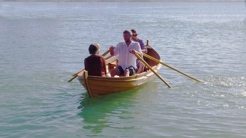 One of the launch party takes a turn at the oars with Jamie rowing in at the forward station and Ingvild seated in the stern.