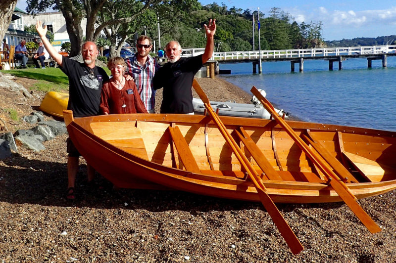 After weeks of hard work, Ulf, Ingvild, Jamie, and John get ready to launch and the spissbåt boat at the beach in Russell.