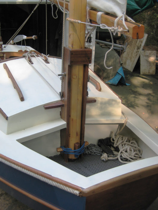 Cutting the Tread Lightly's foredeck provided clearance for the mast to heel to pivot in its tabernacle and recessed well for the anchor.