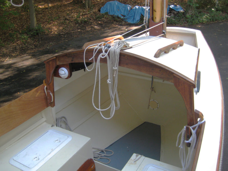 The shortened cabin leaves more room in the cockpit; eliminating the bulkhead and hatch makes access to day-sailing gear easier.