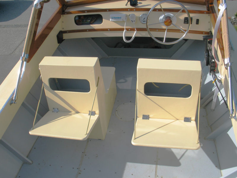 The seats the author designed and built have folding seats facing aft for extra passengers and conceal the gas tanks.