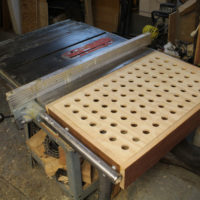 A simple downdraft table can put the space between the rip-fence rails to good use.
