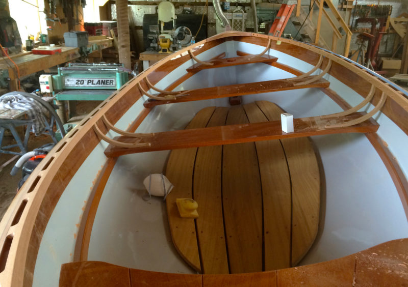 The strip-built hull, reinforced with fiberglass inside and out, offers a clean, easily maintained interior.