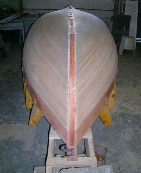With the cypress planking completed, the centerline can be smoothed or the installation of the keel and false stems.