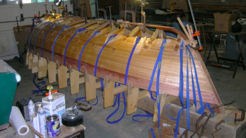 During the planking of the hull, cam-buckle straps pulled each new strip tight against its neighbor. A mahogany sheer strake, finished bright, will give the peapod a more traditional appearance when the rest of the hull is painted.