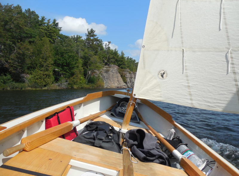 Sailing eastward through Collins Inlet, a narrow cliff-lined passage 10 miles long. With a following wind that grew stronger as the day went on, I kept the boat on a broad reach and tacked my way downwind to avoid constant jibes in the shifting gusts.